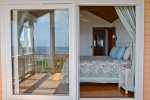 Looking into guest king bedroom from it`s private deck